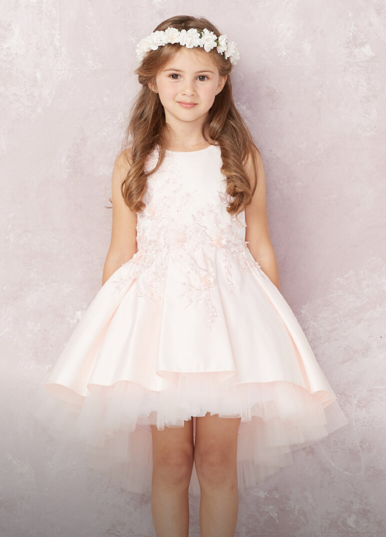 Flower girl in a light pink dress