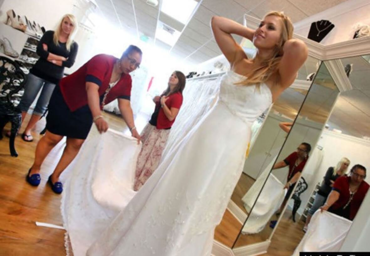 Bride-to-be trying on wedding dresses